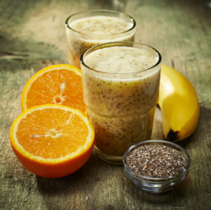Healthy banana and orange juice smoothie with chia seeds, filtered image